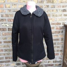 Free People faux fur collar jacket Black jacket by FREE PEOPLE. Excellent used condition. Lightly worn. Faux fur collar in gray. Zip up front. Size medium  65% polyester 35% rayon Free People Jackets & Coats Puffers