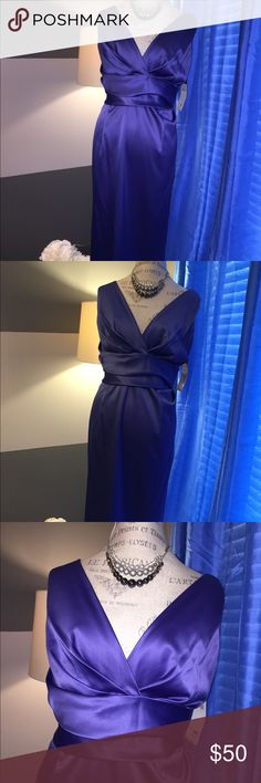 NWT Donna Rico Satin V Neck Midi Periwinkle Dress Brand New Donna Rico NY Size 14W Satin V Neck Cocktail Dress perfect for many special occasions.  This dress is so flattering and slimming with the cross cross rousching around the stomach. Dress is in excellent condition.  All of our products comes from a smoke, pet and perfume free home environment. Donna Ricco Dresses Midi