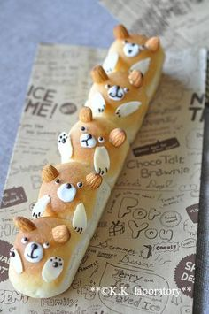 bear family bread - almonds to make ears and paws. I'll have to try it first with Pillsbury loaf bread and then try my own bread recipe.