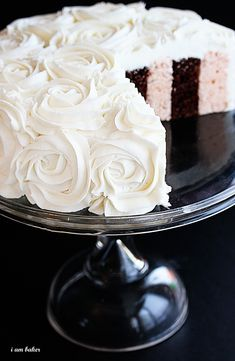 Striped Cake with Frosting Rosettes  tutorial: http://iammommy.typepad.com/i_am_baker/2011/02/rose-cake-tutorial.html