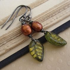 Items similar to Leaf earrings, green czech glass leaves, copper freshwater pearls, oxidized sterling silver on Etsy