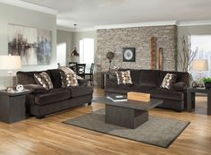 This Ashley Furniture loveseat is all about a laid-back style. It is both durable and ultra-comfortable which ensures that this will be a favorite place to snuggle up and relax.