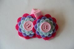 Baby Hair Clips in Wool Felt Pink Purple and Blue Flowers Toddler Hair Clips Girls Hair Clips. $7,99, via Etsy.