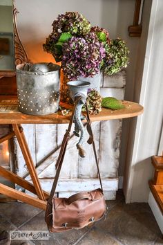 A vintage ironing board entry table with illuminated minnow bucket, decked out for fall. http://www.funkyjunkinteriors.net/ #falljunkersunited
