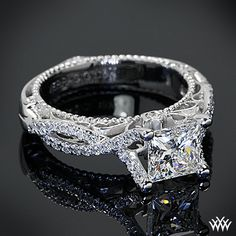 This Verragio Pave Twist Diamond Engagement Ring is set in 18k white gold and holds a 1.083ct A CUT ABOVE® Princess Diamond.