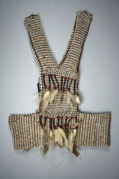 Indonesia, Papua Province (Irian Jaya)   Garment from the Asmat people   Fiber, seeds, cassowary quills, feathers   mid to late 20th century