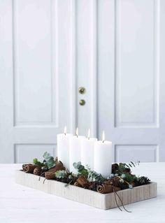 Centros de mesa con piñas, eucalipto y canela