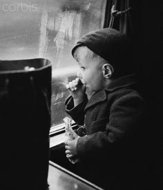 Bert Hardy Young evacuee on train 1942.   --thinking how hard it was for parents to send their children away during the Holocaust. Total love of their child to keep them alive.