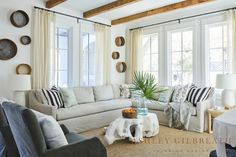 ASHLEY GILBREATH INTERIOR DESIGN: Exposed beams in this Rosemary Beach living room set the tone for the neutral color pallet. A slipcovered sectional by Verellen and a sisal rug make for easy maintenance and family-friendly living. Vintage sieves hung in groups and sheer drapery add additional texture to this space. Ashley Gilbreath, Cottage Living Rooms, Beach Living Room, Living Room Sets, Marble Coasters, Ceramic Table Lamps, Recycled Glass, Design Development, Home Collections