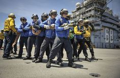 PACIFIC OCEAN (June 20, 2014) Sailors from the aircraft carrier USS Nimitz (CVN 68) conduct a firefighting drill on the flight deck. Nimitz is currently underway performing routine operations and training exercises. (U.S. Navy photo by Mass Communication Specialist 3rd Class Aiyana S. Paschal/Released)