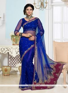 Amazing blue net designer saree is create with embroidered, resham, stone and patch border work adds gleam to your charming looks. Comes with matching blouse. (Slight color variation is possible.)...