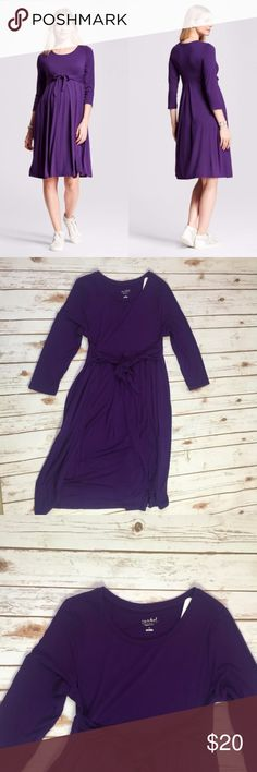 Purple Maternity Easy Tie Waist 3/4 Sleeve Dress Soft and stretchy knit fabric make this maternity dress an easy, comfortable pick from early in pregnancy until after baby. The attached ties can be knotted in front or back for a fitted, versatile look.  Jersey knit type, mid weight fabric.  Made by Ingrid & Isabel for Isabel Maternity. 3/4 Length Sleeve.  Materials:  95% Rayon 5% Spandex  Suggested size 8-10  No Trades Ingrid & Isabel Dresses