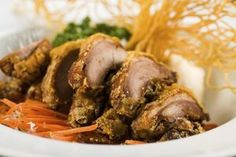 Deep-fried duck is crispy on the outside and moist on the inside.