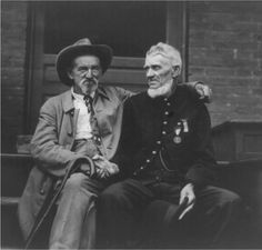 Two veterans of the battle of Gettysburg sitting together at the Gettysburg Celebration, Pennsylvania 1913.