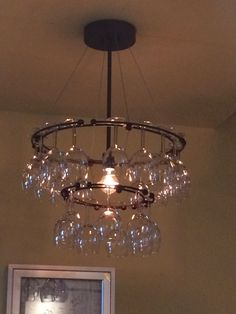 Wine glass chandelier Coolest thing ive ever seen ! Wine Themed Decor, Wine Glass Chandelier, Wedding Day Checklist, Vides, Wine O Clock, Inspiring Things, Interior Design Living Room, Light Fixtures, Outdoor Bars