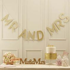 Our Mr & Mrs Gold Bunting helps create a fun and relaxed mood at any wedding venue with a gold or pastel pink theme.Mr & Mrs Gold Bunting - This stunning and eye catching Mr and Mrs bunting is perfect to glitz up any wedding venue. Gold Glitter Wedding, Gold Wedding Theme, Wedding Venue Decorations, Mr And Mrs Wedding, Wedding Dj, Wedding Signs, Wedding Reception, Wedding Venues, Metallic Weddings