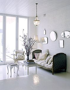 ~ so love the antique daybed floating in pure white ~ it gives these lovely, old souls a modern edge... www.empirevintage.com.au