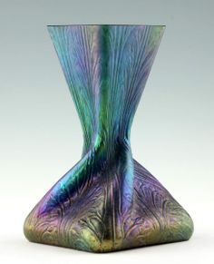"""Rindskopf Söhne c.1900 vase in an optical model blown green glass. Square shape with 45° twisted neck and a square opening. 9in tall, base 5.5in X 5.5in. A vase of this type are found in the book: Passau Glass Museum (ed.) """"Bohemian Glass 1700-1950"""" volume IV, page 179."""