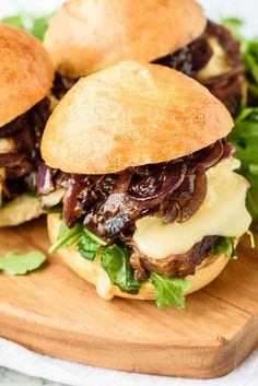 Steak Sandwich Sliders with Brie, Caramelized Onions, and Fig Jam. Both elegant and satisfying, this appetizer recipe is perfect for a party or special dinner.