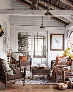 Rustic enclosed porch. Gorgeous garden, gorgeous porch.  Smith & Hawken seating, accessorized with Best Slipcover pillows, furnishes the enclosed porch of this Vermont home.