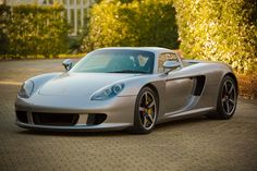 Porsche Carrera GT Dream cars Porsche Carrera GT Oh yeah, another Porcshe—this one a direct heir to the racing glory of the 911 series. The Porsche Carrera GT was developed with the racetack in… Porsche Carrera Gt, Ferdinand Porsche, Jaguar Accessories, Lexus Lfa, Car Racer, Jaguar Xk, Nissan Gt, Performance Cars, Sport Cars