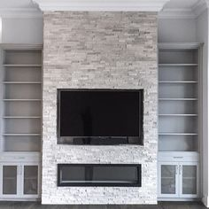 Just Installed. A room completely transformed with an inviting feature wall, beautiful material selection, custom cabinetry and a sleek linear fireplace. - centre - Book Your Complimentary In-Home Design Consultation organizedinteriors. Fireplace Feature Wall, Feature Wall Living Room, Fireplace Tv Wall, Linear Fireplace, Basement Fireplace, Family Room Fireplace, Fireplace Built Ins, Fireplace Remodel, Modern Fireplace
