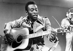 Pele playing guitar at the Cannes Film Festival in 1977
