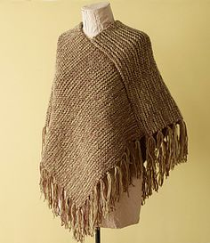 Knit this elegant poncho with the Martha Stewart Crafts Lion Brand Yarn Knit & Weave Loom Kit. (Lion Brand Yarn) free pattern