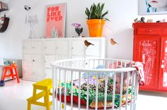 white nursery with colorful details