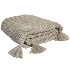 Liven up your home décor with the Knit Throw with Tassels, x Taupe. Visit your local At Home store to purchase and find other affordable Throws & Blankets.