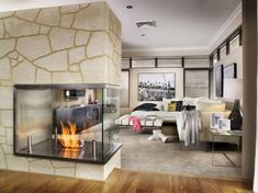 EcoSmart Fireplace with a three-sided view is a beautiful touch for a modern home plan!