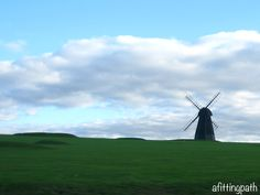 A windmill seen from the road in southern England near Brighton.