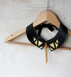Geometric collar necklace in black and gold leather by Tzunuum, $49.00