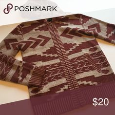Thick tribal zip up hoodie Could be for girls too! From F21. Cool tribal print, zip up and hoodie. Pretty warm too! Sweaters Zip Up