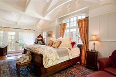 The headboard of a sleigh bed is low enough to be placed in front of a window without blocking most of the light.