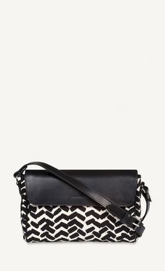 987414ff2913 This beautiful handbag with a black and white Sahalaitaraita pattern has  vacetta leather trimmings