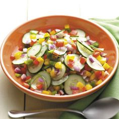 Cucumber Salad with Peppers and Onion Recipe -This crisp and colorful salad is an ideal way to use up all that…