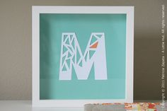 Type and print out a large bold letter that is at least 4 in (10 cm) tall, trace the printout on card stock if you can't print out just an outlined letter, cut out random shapes—but be sure to leave a border so it won't fall apart. Done!
