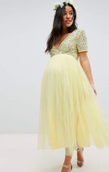 b9eac5da53a8a Beautiful yellow maternity dress. Great for a wedding. Click this pin to  find it
