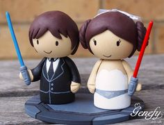 Cute STAR WARS Wedding Cake Topper  Princess Leia in gown and Han Solo in tux! Lightsabers included.  https://www.facebook.com/genefyplayground