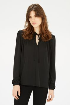 This blouse is constructed from a soft crepe fabric and features a self-tie neck bow, full length sleeves and concealed button closure. Height of model shown: 5ft 10 inches/178cm. Model wears: UK size 10.