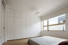 The entrance level's master bedroom has engineered oak floors and a full wall of built-in closets.