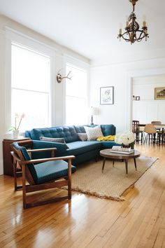 Living room. Modern Blue couch with touches of yellow. Jute rug.