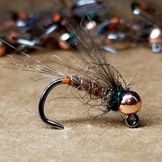 A variation of the famous tungsten bead head frenchie nymph, CA Guide Brent Kinner added some CDC and a orange hot spot. This fly is usually tied on when he hits the water. *Tied on the new Hanak H 490 Jig Trophy Hook and a slotted tungsten bead Nymph Fly Patterns, Fly Tying Patterns, Gone Fishing, Fishing Tips, Fly Fishing Nymphs, Fly Tying Desk, Fish Home, Trout Fishing, Bead