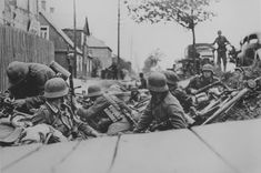 German soldiers hiding in a ditch during street fighting in Kaunas.