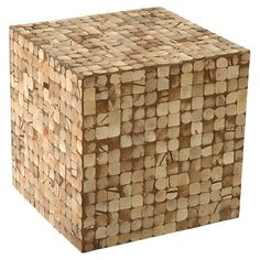 Perfect as an end table at your sofa or a footstool by your favorite arm chair, this handmade cubic ottoman is covered in coconut shells.  What about making this from wine corks!  Totally do-able, no?  ...