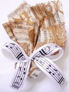 Pretty fabric-wrapped favors with a sheet music theme