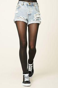 A pair of knit semi-sheer tights featuring an elasticized waist.