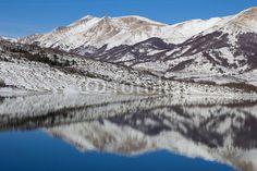Campotosto lake at winter season, Abruzzo - Italy. #Winter #Snow #Tourism #Travel #Apennines #Mountains #Reflects #Lake #Campotosto #Tourism