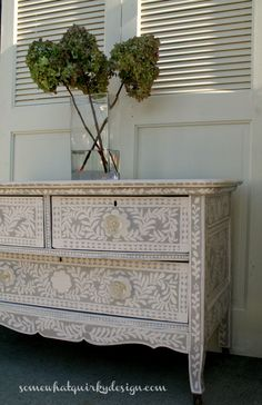 This low-boy dresser is painted with Annie Sloan's Paloma and handpainted with a mix of Old White and Antoinette. Knobs from Hobby Lobby. Instructions are available on the blog. Somewhat Quirky: Painted Inlay Dresser